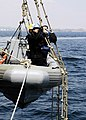 US Navy 060406-N-2385R-237 Deck Department personnel lower a rigid hull inflatable boat (RHIB) into the water during a man overboard drill as part of a friends and family day cruise.jpg