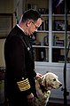 US Navy 061215-N-0696M-013 Chief of Naval Operations (CNO) Adm. Mike Mullen and his dog Gracie stand in place during a taping for a holiday greetings message to be broadcast around the world on American Forces Networks.jpg