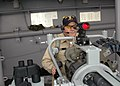 US Navy 070117-N-6482W-005 Master Chief Culinary Specialist Scott Montgomery stands watch on the MK-38 25mm machine gun aboard the multi-purpose amphibious assault ship USS Bataan (LHD 5) while transiting through the Mediterran.jpg