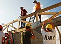 US Navy 070503-N-1831S-038 Sailors from the Kearsarge Expeditionary Strike Group and local Fort Lauderdale volunteers work together to lift a roofing frame.jpg