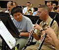US Navy 070505-N-0773H-002 A student finalist in the U.S. Navy Band High School Concerto Competiton, plays oboe alongside oboe instrumentalist Senior Chief Musician Scott Alexaneder in the sail loft on board the Washington Navy.jpg