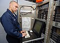 US Navy 080823-N-9079D-037 Information Systems Technician Seaman Joel V. Lasko, from Salisbury, Conn., performs backups on Centrixs in the tactical automated information systems center aboard the aircraft carrier USS Abraham Li.jpg
