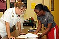US Navy 080923-N-2539L-020 Chief Cryptologic Technician Collection Jennifer Hawkes talks with Benedict College student Shameka Archield.jpg