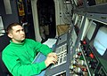 US Navy 081026-N-2456S-014 Interior Communications Electrician 3rd Class Daniel Whittington stands watch in the integrated launch and recovery television surveillance control room.jpg