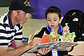 US Navy 081028-N-XXXXK-001 Fire Controlman 2nd Class Matthew B. Powell reads a children's book during a community relations project at the Hong Kong Society for the Protection of Children Nursery School.jpg