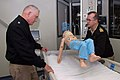 US Navy 090209-N-5086M-005 Capt. Gregory Blaschke, medical director, Medical and Surgical Simulation Center at Naval Medical Center San Diego, right, demonstrates the mobile child trainer.jpg