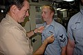 US Navy 090806-N-8119A-036 Vice Adm. John Donnelly, commander, Submarine Force, pins an enlisted submarine warfare qualification device onto Machinist Mate 2nd Class Charles Curtis while visiting the ballistic missile submarine.jpg