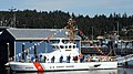 US Navy 090818-N-1325N-003 U. S. Coast Guardsmen man the rails as the U.S. Coast Guard Cutter Sea Fox (WPB 87374) is brought to life at Naval Base Kitsap.jpg