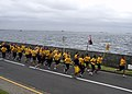 US Navy 090902-N-1251W-001 Chief petty officer (CPO) selects lead area commanders, flag officers and the Far East CPO Mess in a leadership run along the base seawall.jpg