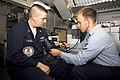 US Navy 091002-N-0096C-018 Hospital Corpsman 3rd Class Anthony Fadich, right, from Wenatachee, Wash., monitors the blood pressure of Logistics Specialist 2nd Class Dan Foster, from Hutchinson, Kan.jpg