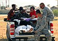 US Navy 100131-N-8822R-128 Members of the U.S. Army 82nd Airborne Division help medically evacuate a Haitian girl and her mother to the U.S. Embassy for medical care.jpg
