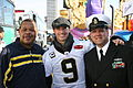US Navy 100209-N-0000X-002 New Orleans Saints quarterback Drew Brees poses for a photo with Federal employee Joe Serals, left, and Senior Chief Interior Communications Specialist Perry Muller before the start of the New Orleans.jpg