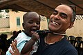 US Navy 100419-M-0000T-003 Cmdr. Antonio Rodriguez, senior medical officer for Africa Partnership Station (APS) West, holds a Senegalese baby during a medical outreach project.jpg