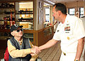 US Navy 100824-N-3038C-222 Command Master Chief Dave Bission visits with Jake Lambert, a WWII Navy Veteran and prisoner of war, at the Veteran's Home during Boise Navy Week.jpg