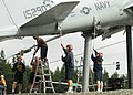 US Navy 100910-N-9520G-012 Chief petty officer selectees work together as they clean the display of the A-6 Intruder during the annual cleaning and.jpg