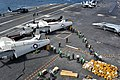 US Navy 110722-N-BR887-022 Sailors move more than ten thousand pounds of mail delivered by two C-2A Greyhound aircraft assigned to Carrier Logistic.jpg