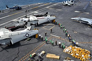 Carrier onboard delivery - Image: US Navy 110722 N BR887 022 Sailors move more than ten thousand pounds of mail delivered by two C 2A Greyhound aircraft assigned to Carrier Logistic