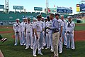 US Navy 110727-N-AW342-177 Cmdr. John McGunnigle presents Sam Kennedy the New Hampshire flag to fly over the park during the game.jpg