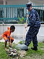 US Navy 110905-N-ZY850-109 Gas Turbine Systems Technician (Electrical) 3rd Class Glenna L. Rankin assists an Indian child from the Juara Boys' Hous.jpg