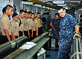 US Navy 110923-N-ET019-552 Electronics Technician 1st Class Joseph Patterson shows a periscope to Navy Junior ROTC cadet.jpg