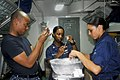 US Navy 110925-N-SF704-102 Hospital corpsmen aboard the aircraft carrier USS George Washington (CVN 73) inspect needles containing influenza vaccin.jpg