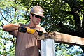 US Navy 111206-A-TF780-032 Builder 2nd Class Nicholas Fox removes rebar from a wooden beam at Centro Escolar Elementary School. NMCB-23 will comple.jpg