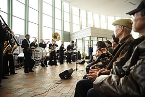 US Navy 120205-N-SD300-198 The U.S. 7th Fleet Band performs at the Rera Chitose Outlet Mall in front of an audience of 444 local residents.jpg