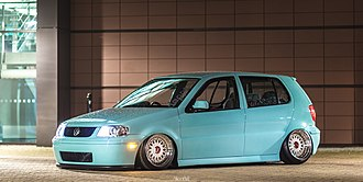 "Car tuning - A MK3 Volkswagen Polo displaying the ""stanced"" look with aftermarket air suspension, light blue paint and BBS RM wheels with negative camber."