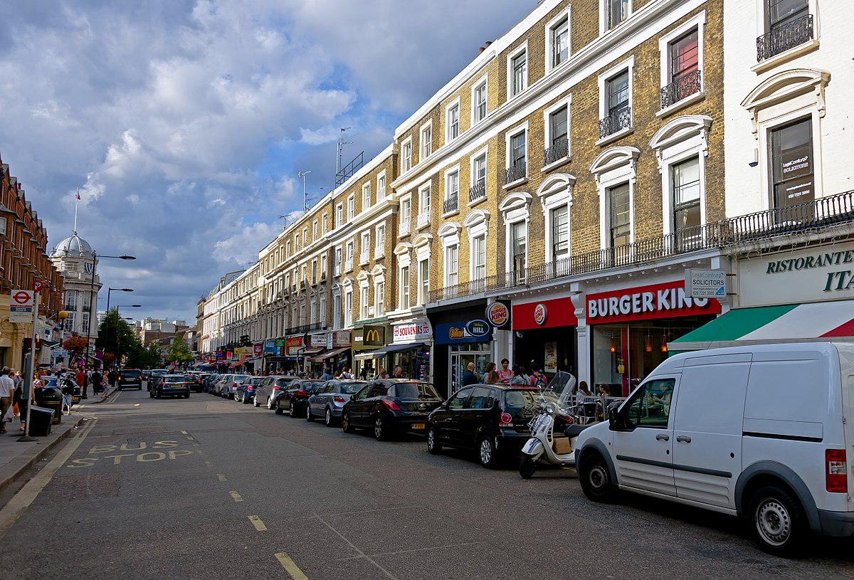 Px View N Up Queensway From Bayswater Tube Station Entrance on Kensington Palace London