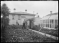 View of the backyard of number 9 Baker Street, Caversham, Dunedin, with the photographer Albert Percy Godber, his wife Laura, and his daughter Phyllis. ATLIB 294713.png