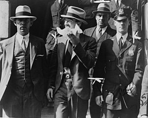 Contract killing - Mad Dog Coll leaving homicide court surrounded by police officers, 1931
