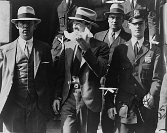 Contract killing - Mad Dog Coll leaving court surrounded by police officers, 1931