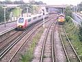 Virgin Trains Super Voyager 221106 WILLIAM BARRENTS passing Millbrook railway station Hampshire UK.jpg