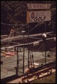 """WORKMEN PUT UP NETTING AT MINI-GOLF CONCESSION NEAR BAGNELL DAM. CONCESSION IS PART OF """"THE STRIP"""", A MILE-LONG... - NARA - 551288.tif"""