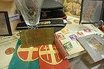 """WW2 Norway. NS (Nazi party Nasjonal Samling) items, ministerpresident Quisling sign, suncross armlets, """"Offentlig sak"""" stamps, VQ glass, etc. Lofoten Krigsminnemuseum 2019-05-08 DSC09998.jpg"""