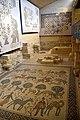 Wall and floor mosaics inside the Memorial Church of Moses. Mount Nebo, Jordan.jpg