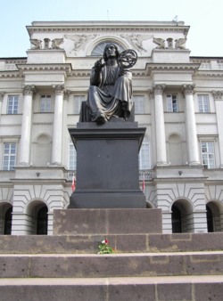 Statue of a seated Copernicus holding a armillary sphere, by Bertel Thorvaldsen, in front of the Polish Academy of Sciences, Warsaw.