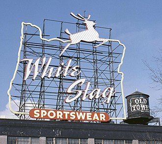White Stag sign - A daylight view in 1985, also showing the adjacent water tower