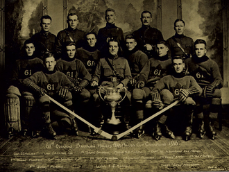 Bullet Joe Simpson - Simpson, sitting third from left, in 1916 with the Winnipeg 61st Battalion and the Allan Cup.