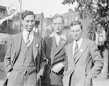 Black-and-white photograph of three men standing together