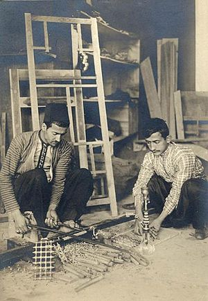 Smoking in Syria - Woodworkers from Damascus, Syria creating wood components for hookah production (19th century)