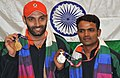 XIX Commonwealth Games-2010 Delhi (Men's Shooting 25 m Centrefire Pistol) Harpreet Singh of India (Gold) and Vijay Kumar of India (Silver), during the medal presentation ceremony, at Dr. Karni Singh Shooting Range.jpg