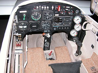 "XCOR EZ-Rocket - Cockpit. Engine on-off switches on left side panel are placarded ""FWD - LOUD; BACK - QUIET"""