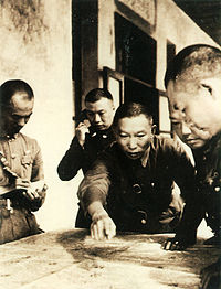Xue Yue discusses strategy.jpg