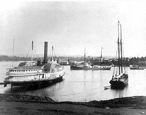 Yosemite (sidewheeler) - Yosemite on the left in Victoria, BC harbor in the 1890s.  The enormous beam of the vessel, made necessary by the sidewheels, is readily apparent, as well as the extensive ornamentation of the all-wooden vessel.