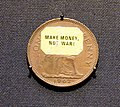 """""""Make Money Not War"""" coin. Sticker added by protesters against the Vietnam War. Copper Penny of Elizabeth II, minted at the Royal Mint, London, 1962. On display at the British Museum.jpg"""