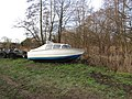 -2021-01-31 Small boat on the banks of the North Walsham and Dilham Canal, Bacton Wood Staithe.JPG