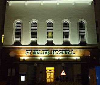 St Helier, London - The art deco entrance of St Helier Hospital floodlit at night