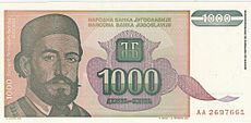 coloured banknote with picture of bearded, mustachioed man
