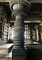 12th-century carved pillar inside Shaivism Hindu temple Hoysaleswara arts Halebidu Karnataka India, inscription below.jpg